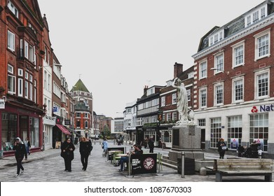 Kingston upon Thames, United Kingdom - April 2018: Kingston Market Place, town centre with lots of shops and stores in old buildings