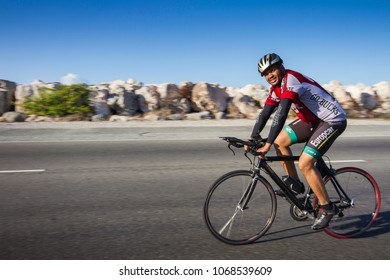 Kingston/Jamaica - April 14, 2018: cyclist riding his bicycle on the roadway