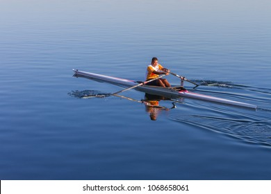 Kingston/Jamaica - April 14, 2018: man rowing a Single Scull