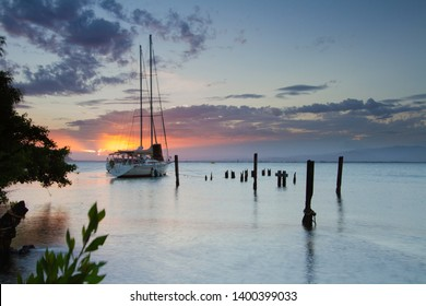 KINGSTON/JAMAICA - MAY 12,2019: Yacht docked in sea port sea at sunset