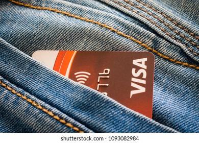 KINGSTON/JAMAICA - MAY 9, 2018: Visa card in blue denim jeans pocket