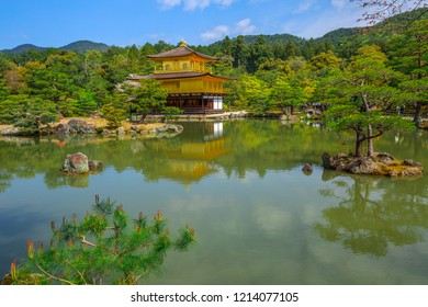 Kinkakuji Golden Pavilion Unesco site of Kyoto, reflected on lake.The Golden Pavilion, whose top two floors are completely covered in gold leaf, is a ancient Zen temple. Day light shot.