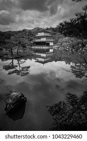 Kinkakuji (Golden Pavilion) is a Zen temple in northern Kyoto whose top two floors are completely covered in gold leaf