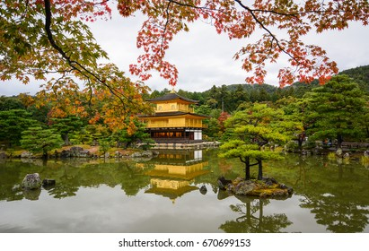 Kinkaku-ji Temple at autumn in Kyoto Japan. The Golden Pavilion (Kinkaku) is one of the most popular buildings in Japan, attracting a large number of visitors annually.