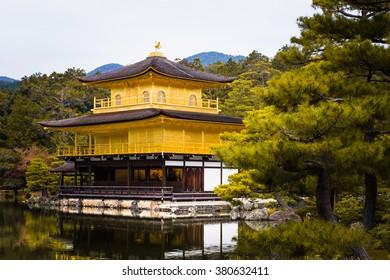 Kinkakuji temple golden pavilian in autumn, pond reflection