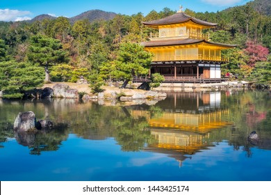 Kinkaku-ji Temple, Kyoto, Japan -November 3, 2019: The Golden Pavilion and the beautiful surrounding Japanese Zen Garden, in the morning with reflections in the water, Kyoto, Japan