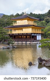 Kinkaku-ji temple (the Golden Pavilion) with Mirror lake and garden in summer in Kyoto, Japan. Zen Buddhist temple