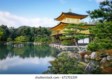 Kinkaku-ji Temple with traditional garden in Kyoto Japan. The Golden Pavilion (Kinkaku) is a three-story building on the grounds of the Rokuon-ji temple complex.