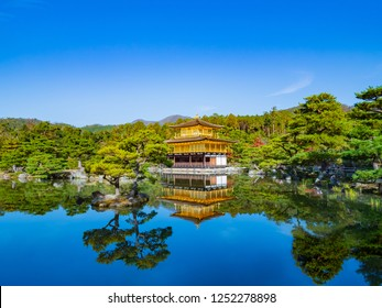Kinkakuji Temple,Beautiful pathway along with the goldren pavilion  and the red color leaf. Enjoy the blue sky, Deep breath with fresh air.