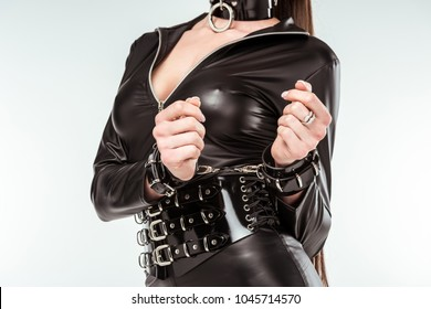 Kinky woman in sexy costume and handcuffs isolated on white