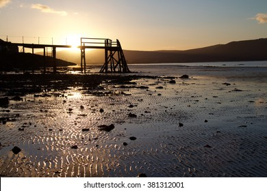 Kinnegar Pier, located in Holywood, Co. Down, beautifully showcases a clear, crisp winter sunset.