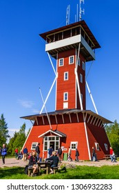 Kinnekulle, Sweden, 2016, May. Tourists at an old wooden lookout tower