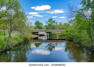 Kinnickinnic River and bridge in spring in River Falls, Wisconsin, USA.