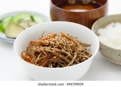Kinpira gobo, chopped burdock root and carrot cooked in sugar and soy sauce