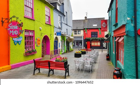 KINSALE, CORK, IRELAND - 06 May, 2018 - Colorful houses in the Market street and the Newman's Mall. The historic streetscape is a famous holiday destination.