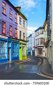 KINSALE, IRELAND - NOVEMBER 6, 2010: Colorful facades of houses on narrow streets of the old town