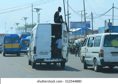 Kinshasa DR Congo Africa  October 14 2016 , Congo people travel by the van in Kinshasa city. He seated on the car roof this activity was unsafe.