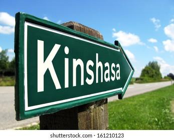Kinshasa signpost along a rural road