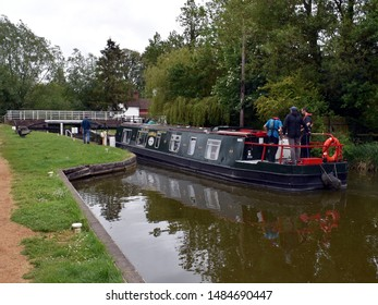 Kintbury, Berkshire/England-May, 26, 2019:  A boat entering a lock on the Kennet and Avon Canal in Berkshire