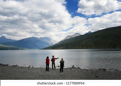 KINTLA LAKE, GLACIER NATIONAL PARK, MONTANA, USA - September 9, 2018: Two tourists discuss Kintla Lake with a National Park Ranger.