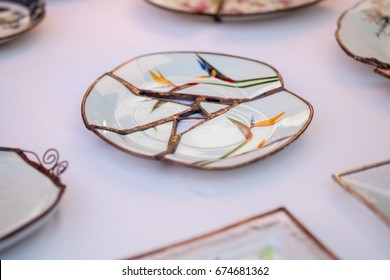 Kintsugi style handcrafted plate sold at handicraft market. Tel-Aviv. Israel, Kintsugi is the Japanese art of repairing broken pottery