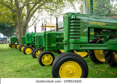 Kinzers, Pennsylvania - August 14, 2019: Row of John Deere tractors at the Rough and Tumble Thresherman's Renuion in Kinzers.