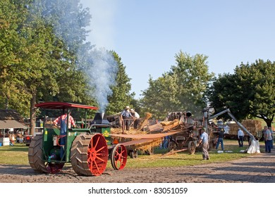 KINZERS,PENNSYLVANIA - AUG 17: A steam tractor is used to power an old grain threshing machine  at Rough & Tumble Engineers 63rd annual Threshermen's Reunion on August 17,2011 in Kinzers,Pennsylvania.