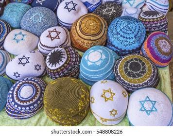 Kippahs Yarmulkes Jewish Hats Covers Israeli Star of David Souvenirs Safed Tsefat Israel.  Kippahs/Yarmulkes are Jewish headgear worn by men during a Jewish.  Required by Judaisim.