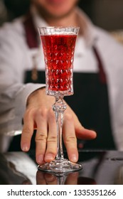 Kir Royal cocktail with orange slice and ice cubes