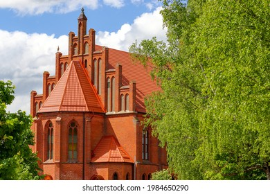 Kirche of the Holy First Apostles Peter and Paul, surrounded by trees. Krasnoznamensk, Kaliningrad region - Shutterstock ID 1984650290