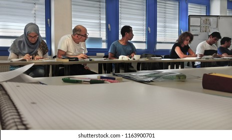 Kirchheimbolanden, Rheinland-Pfalz / Germany, August, 23, 2018: Students of different nationalities and ages, learning a foreign language (german) by immersion in the classroom, selective focus