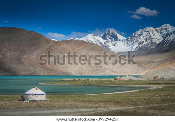 Kirgiz yurt on the shore of the Kara Kul lake in Karakorum, China