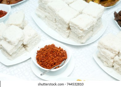 Kiribath, Milk Rice Plates on Table with Red Chilly Curry