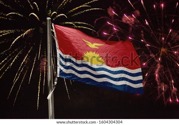 Kiribati flag blowing in the wind at night
