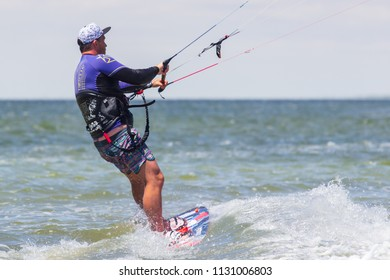 Kirilovka. Ukraine. July 1, 2018. A kite surfer rides the waves, makes trick
