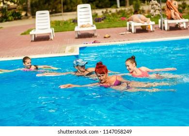 Kirilovka/Ukraine - June 02 2017:  people are engaged in water aerobics in pool