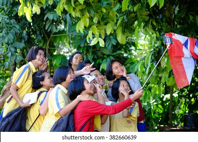 Kiriwong, Thailand - February 21, 2016. A group of students try to selfie their good moment together at Kiriwong Village, a nice beautiful quiet village, Nakhon Sri Thammarat, Thailand.