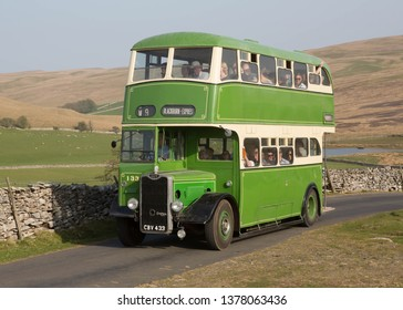 KIRKBY STEPHEN ENGLAND, APRIL 20 2019 Former Blackburn Corporation 1949 Guy Arab 111 preserved double decker bus with Crossley body on a scenic run on a moorland road