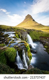 Kirkjufell Mountain in the Snaefellsnes Peninsula, waterfall and landscape in Iceland
