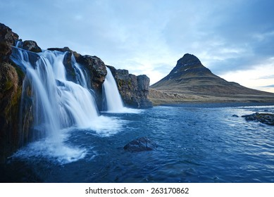 Kirkjufell mountain with waterfall cascades in iceland