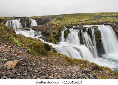 Kirkjufellsfoss and the surrounding cascading waterfalls - long exposure (Iceland)