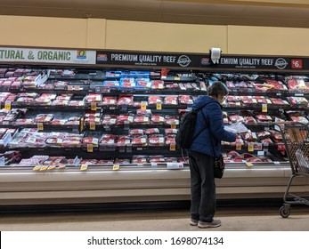 Kirkland, WA / USA - circa April 2020: Senior customer shopping during special elderly hours at a Safeway grocery store during the COVID-19 outbreak.