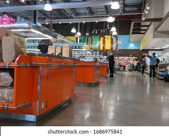 Kirkland, WA / USA - circa March 2020: View of the hot buffet food area inside a Whole Foods, mostly abandoned during the COVID-19 coronavirus outbreak.