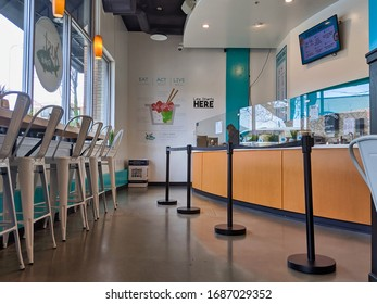 Kirkland, WA / USA - circa March 2020:View of an empty Just Poke restaurant downtown during the shelter-in-place order in Washington amidst the COVID-19 coronavirus pandemic.