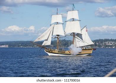 KIRKLAND, WASHINGTON - AUG 31 - The wooden brig, Lady Washington, fires her cannon   during a mock sea battle as part of Labor Day festivities on Aug 31, 2012 near Kirkland , Washington.