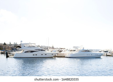 Kirkland, Washington, USA. February 2020. The waterfront of lake Washington in clear weather. View of moored yachts near the shore.