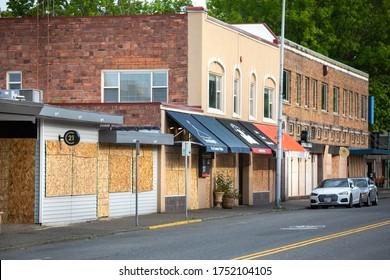 Kirkland, Washington / USA - June 2 2020: Boarded up small businesses in downtown Kirkland