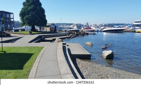 Kirkland, Washington/United States - 07/18/17: Boats, pier, docks and park at Kirkland Homeport Marina