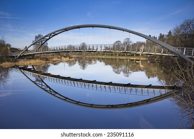 The Kirkpatrick MacMillan bridge (at the end of Dock Park in Dumfries) reflected in the River Nith. Taken at Dumfries, Dumfries and Galloway, Scotland, UK.