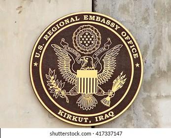 KIRKUK, IRAQ - CIRCA MAY 2007: Embassy seal, misspelled, on a blast barrier T-wall